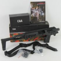 A Micro Roni conversion system for the Glock 19 and Glock 23. CAA manufacture and 'as new' in box.