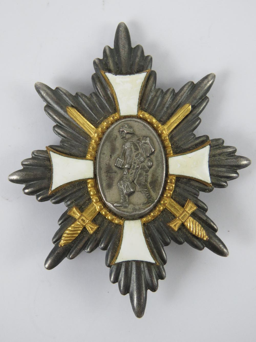 A WWI German Deutsches Feld-EhrenZeichen badge having white enamel cross to front,