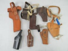 A quantity of seven holsters including a Broomhandle mauser, a colt pythan, s&w,