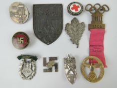 A quantity of assorted WWII German day badges including; 1944 Warschau, 1936 XI.