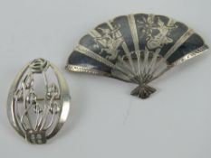 A Charles Rennie Mackintosh inspired silver brooch, oval frame with floral pattern within,