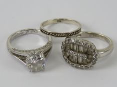 Three silver rings sizes L-M, each stamped 925.