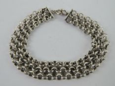A heavy HM silver three row chain bracelet, hallmarked for London, 18.5cm in length, 23g.