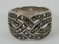 A silver and marcasite ring having four rows of 'woven' marcaties, graduated band measuring 1.