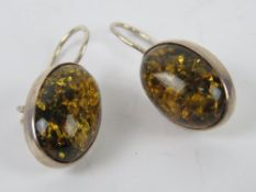 A pair of Baltic Amber earrings, each cabachon approx 1.8 x 1.