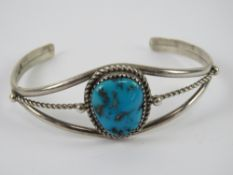 A Richard Begay Native American (Navajo) sterling silver cuff style bangle set with turquoise,