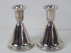 A pair of silver Chrisophersen short candlesticks,
