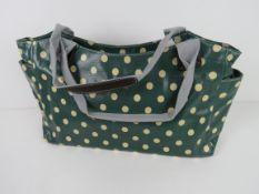 A green polka dot pattern handbag 'as ne