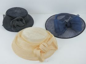 Three ladies hats being blue, cream and