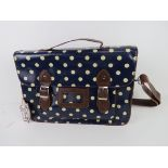 A blue polka dot satchel type handbag 'a
