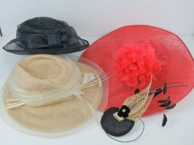Three ladies hats in navy, cream and red