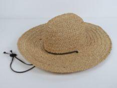 A handmade raffia straw hat made by Scal