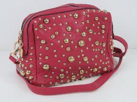 An 'as new' pink studded handbag handbag
