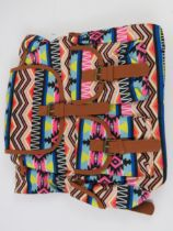 An Aztec pattern multi coloured ruck sac