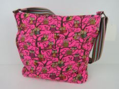A fabric tote bag having owl pattern in