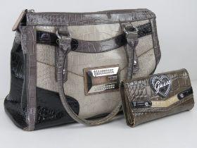 A Guess handbag with coordinating purse