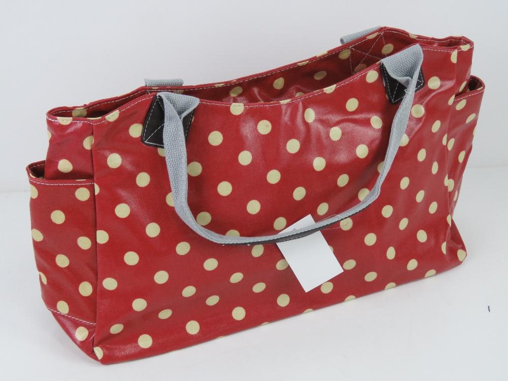 An 'as new' red polka dot handbag 49 x 2