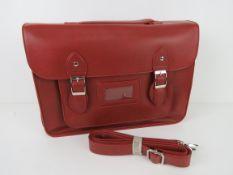 A burgundy satchel type handbag 'as new'