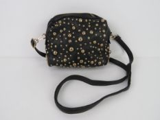 A black handbag with stud decoration 'as