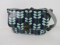 A leaf patterned handbag in blue 'as new