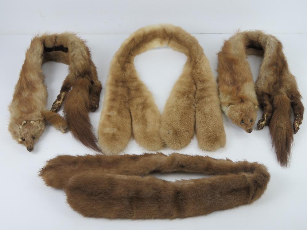 Four vintage fur collars.