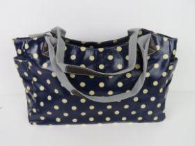 A blue polka dot pattern handbag 'as new
