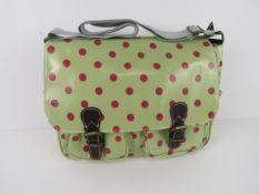 A green polka dot satchel type handbag '