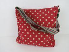 A fabric tote bag red polka dot pattern