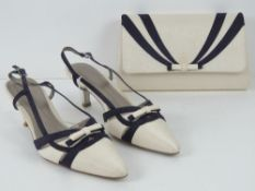A pair of Jacques Vert purple and cream