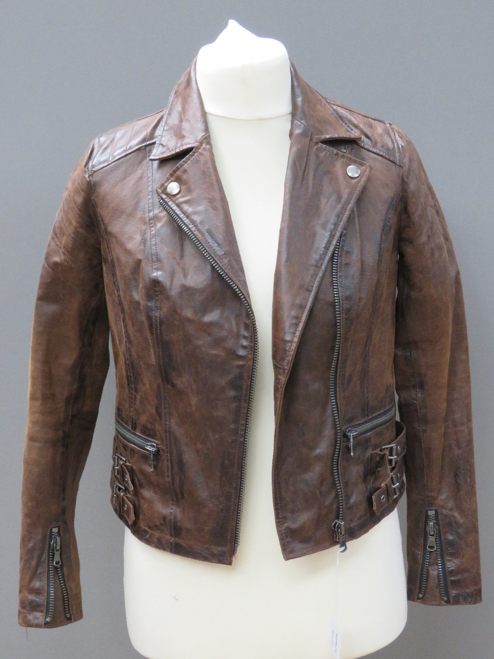 A brown leather biker style jacket by Ne