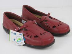 A pair of 'as new' red leather shoes by