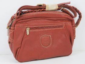 A vintage Italian made handbag in red, m