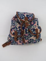 A navy and pink butterfly themed rucksac