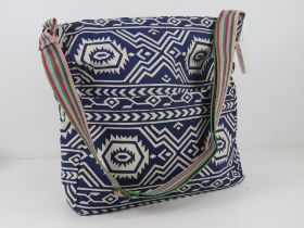 A fabric navy blue Aztec pattern tote ba