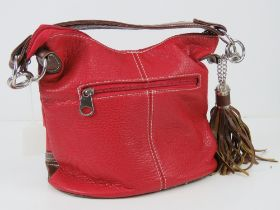 A red and brown Paula Rossi handbag with