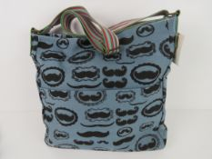 A fabric tote bag having mustache patter
