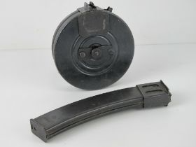A PPSH-41 drum magazine together with a