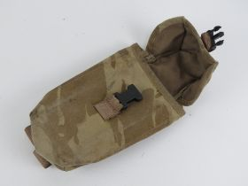 A desert camouflage magazine pocket.