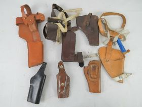 A quantity of seven holsters including a