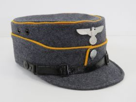 A WWII German NSFK (National Socialist Flying Korp) Kepi peaked cap bearing makers mark and size 57
