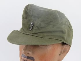 A green cloth 'tropical' cap having removed label and removed cloth badge from front.