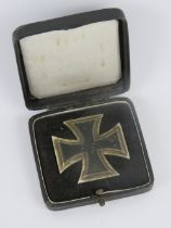 A WWII German first class Iron Cross in presentation box, pin stamped '20'.