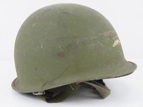 A US M1 helmet with Vietnam liner.