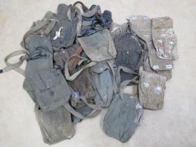 A quantity of assorted AK magazine pouches.