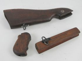 A WWII Thompson woodwork set including stock, pistol grip and foregrip.