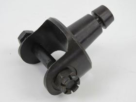 A .30 cal pintle having nut and bolt.