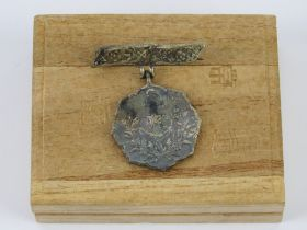 A WWII Japanese Navy pin badge in box.