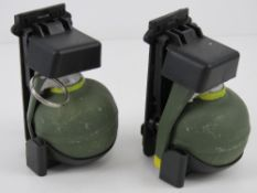 Two inert dummy grenades with grenade ho
