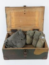 A German ammunition box having camo paint upon, stencilling and dated 1935.