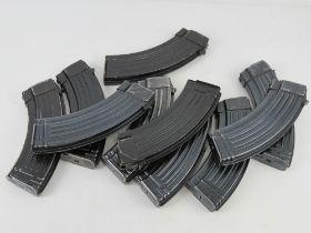 A quantity AK 7.62 magazines. Ten items.